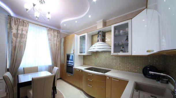 Конструкция из ГКЛ в бело-розовых тонах, зонирующая пространство кухни